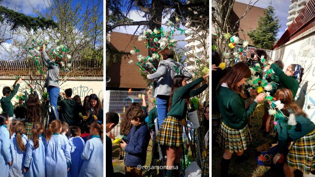 Niños montando el árbol con material reciclado